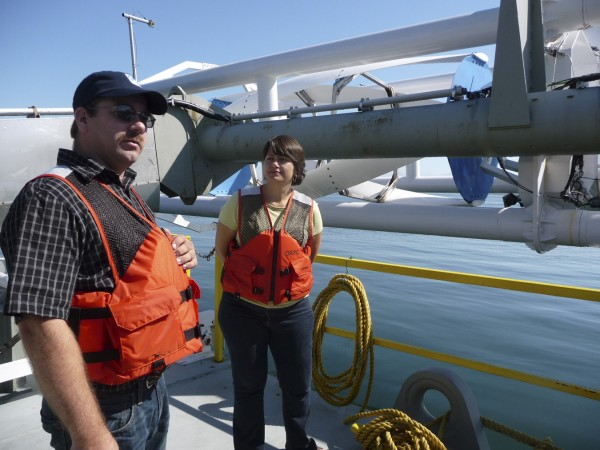 Project Manager David Turner and Ocean Renewable Power Company spokesperson Suzy Kist explains how the company's 40-foot, 37,000 pound hydroturbine works during an open house on the company's barge in 2011.