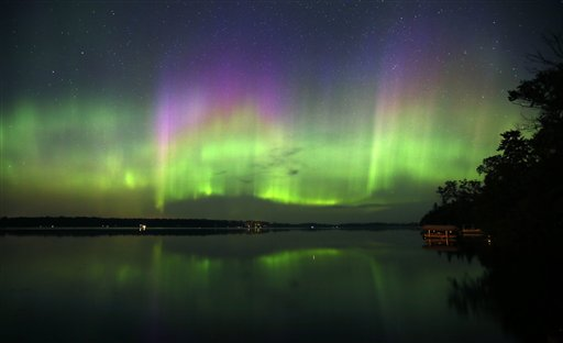 Northern Lights illuminate the sky over Lake Elora in northern Minnesota early Sunday morning, July 15, 2012.