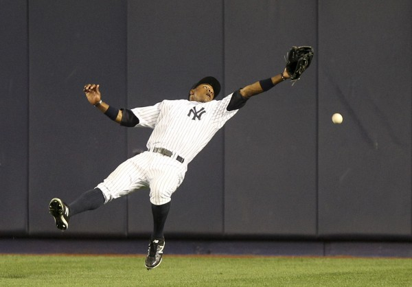 New York Yankees' Curtis Granderson can't catch a triple hit by Boston Red Sox's Pedro Ciriaco during the ninth inning of the baseball game at Yankee Stadium in New York, Saturday, July 28, 2012. The Red Sox beat the Yankees 8-6.