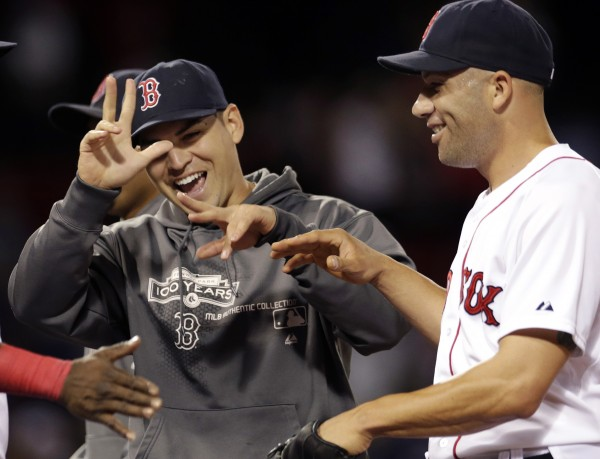 Boston Red Sox closer Alfredo Aceves, right, celebrates with Jacoby Ellsbury after their 5-1 win over the Toronto Blue Jays in a baseball game at Fenway Park in Boston, Tuesday, June 26, 2012. Ellsbury is on a rehab assignment in the minor leagues and is expected to join the Portland Sea Dogs for their series Wednesday in Manchester, N.H., against the Fisher Cats.