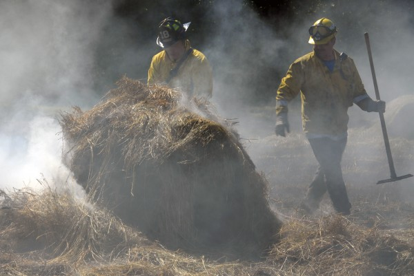 Eight or nine Lincoln and Mattawamkeag firefighters stopped a hay field fire after it torched 2 acres at a farm off Bagley Mountain Road in Lincoln on July 11, 2012.