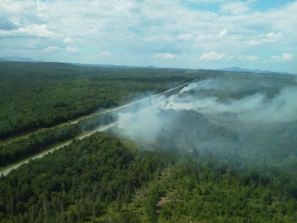 A Maine Forest Service helicopter captured images of a series of 24 to 30 grass fires along Interstate 95's northbound lane from Carmel to Sherman that investigators believe was caused by debris falling from a truck on Tuesday, July 10, 2012.