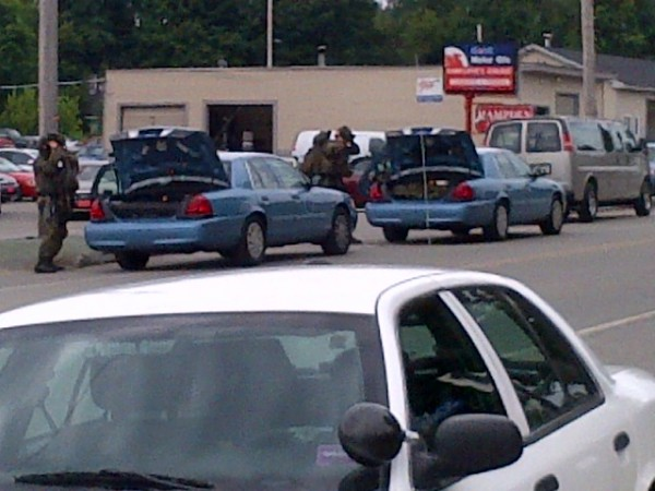 A Maine State Police tactical team prepares to go into the scene of the shooting on Marina Road in Hampden.