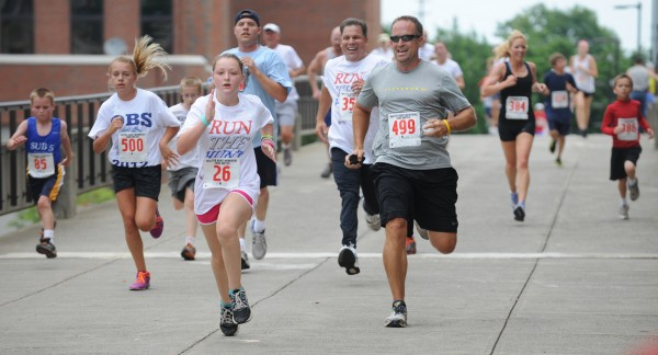 Runners, young and old, kick to the Bangor finish of the 32nd annual Walter Hunt Memorial 3K road race Wednesday, July 4, 2012.