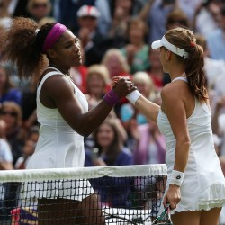 Serena Williams (left) shakes hands with Agnieszka Radwanska after Williams captured the Wimbledon women's singles final 6-1, 5-7, 6-2, in Wimbledon, England, on Saturday, July 7, 2012.