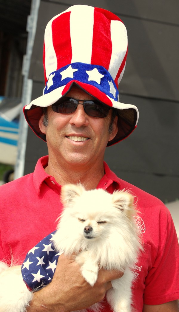 Eastport Airport Manager Steve Trieber dressed the part, as did Pitot, his Pomeranian pooch, while hosting the Independence Day pancake breakfast served Wednesday at the airport to more than 800 hungry patrons.