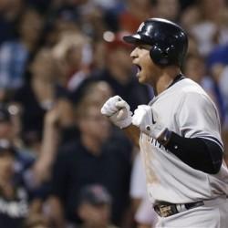 New York Yankees' Alex Rodriguez celebrates as he crosses home plate to score on Mark Teixeira's triple in the seventh inning of a baseball game against the Boston Red Sox at Fenway Park in Boston Friday, July 6, 2012.