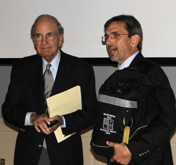 Former Sen. George Mitchell (left) accepts a gift from the University of Maine's Ivan Fernandez after Mitchell spoke Thursday, July 19, 2012, to the BIOGEOMON Conference at Point Lookout in Northport.