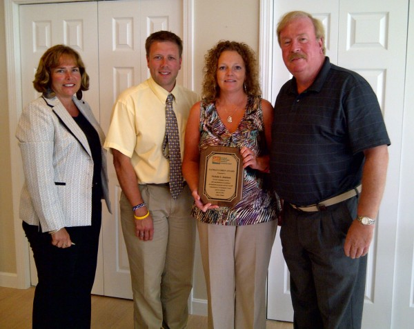 Nichole Jamison receives the Nathan Cohen Award at the annual meeting of the Aroostook Washington County Workforce Investment Board in Lubec. With Jamison are, from left: Jeanne Paquette, deputy commissioner of MDOL; Ryan Pelletier, executive director Aroostook Washington WIB; Jamison; and Barry McCrum, chairman Aroostook Washington WIB.
