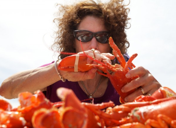 Catherine Davidson of Maryland chows down on as many lobster as she can in 10 minutes during a crustacean eating contest in Portland this summer. A second cruise ship has committed to buy thousands of pounds of Maine lobster when it visits Portland this summer.