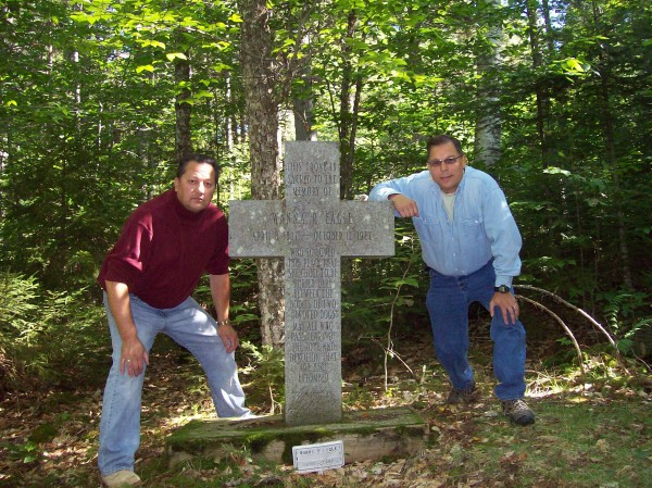 Houlton Band of Maliseets Rep. David Slagger, right, poses with Henry Bear, another Houlton Band member, at the gravesite of Wanna Eagle on Sugar Island. Eagle was the wife of Chief Henry Red Eagle, a Greenville native and first Native American graduate of Greenville High School.