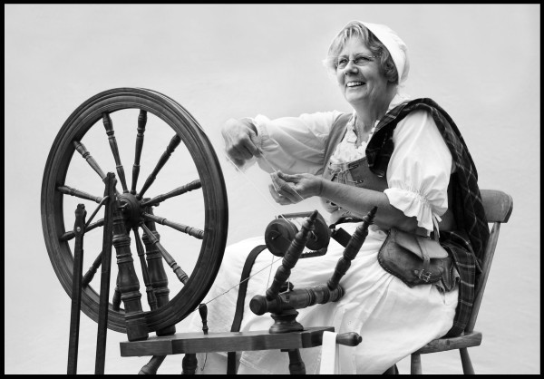 Ann McDougal of Hartland spins Romney wool the was it was done in 1779. She's a member of a re-enactment group portraying the 74th Highland Regimen, which were garrisoned in Castine during the Revolutionary War.