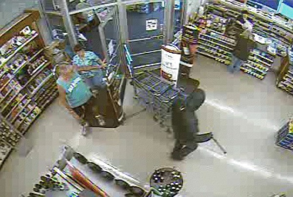 This video surveillance still, taken around 7 p.m. Wednesday at Rite-Aid in Bucksport, shows the man police say robbed the pharmacy. The man was carrying a cane, which police suspect was a prop. Police are seeking information that could lead to the man's identity.