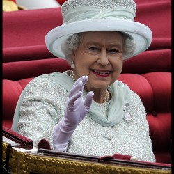 Queen Elizabeth waves from her carriage on Whitehall on her way to Buckingham Palace as part of the Queens Diamond Jubilee, Tuesday, June 5, 2012, in London, England.