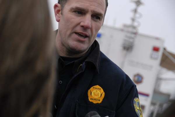 Bangor police Lt. Mark Hathaway briefs the media as members of the Bangor Police Department participate in a mock crisis drill in February 2007.