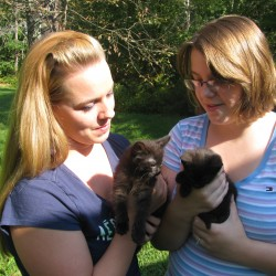 Misti Blair (left) and Amber Springer, both of Belfast, rescued these two kittens on Saturday from a burlap bag abandoned on the side of the Back Belmont Road.