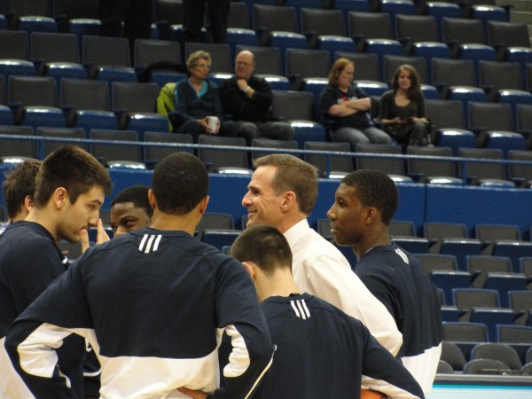 Ed Kohtala talks with University of Maine players before a game last season. The Vienna native has been hired as the head boys basketball coach at Bangor High School.