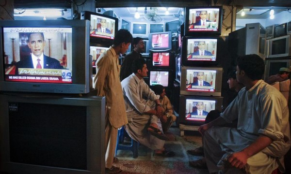 Shopkeepers gather around television screens showing a speech by U.S. President Barack Obama as he announced the death of al Qaeda leader Osama bin Laden at a market in Quetta May 2, 2011.