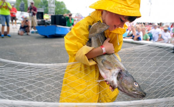 Nine-year-old Noah Lachance of Camden was the fastest in the children's codfish carry event at the 65th annual Maine Lobster Festival in Rockland on Sunday, Aug. 5, 2012.