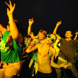 Sisters Kristina (right) and Kendra Toellner, both 19, groove to Bassnectar during Saturday night's installment of the KahBang festival on Bangor's waterfront.