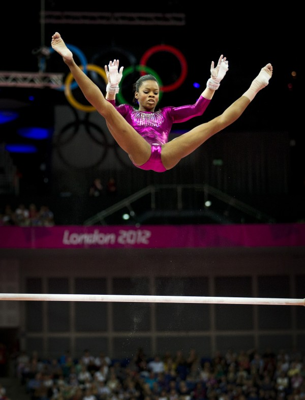 Gabrielle Douglas of the United States competes on the uneven bars on her way to winning gold in the women's individual all-around gymastics competition during the 2012 Summer Olympic Games in London.