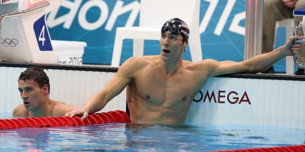 U.S. swimmer Michael Phelps, right, and Ryan Lochte look up to the scoreboard after finishing the men's 200m individual medley final at the Summer Olympic Games Thursday, August 2, 2012. Phelps won Gold, Lochte, Bronze. (