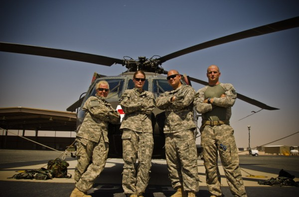 Maine Army National Guard Staff Sgt. Jessica Wing (left) stands with members of Bangor's 126th Aviation Medevac unit in the Middle East in this undated photo with a UH-60 Blackhawk in the background. Wing, 42, who was from Glenburn, Maine, and Alexandria, Va., was a crew chief and died on Monday, Aug. 27, 2012, while serving in Kuwait.