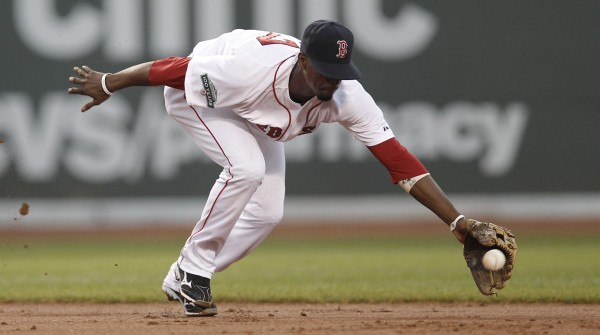 Boston Red Sox second baseman Pedro Ciriaco cannot get to a single hit by Minnesota Twins' Brian Dozier during the third inning of a baseball game at Fenway Park in Boston, Thursday night, Aug. 2, 2012.