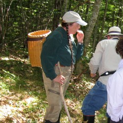 Wanda wears her pack basket while guiding a nature walk in the Rockland Bog.