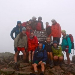 The 2012 Maine Youth Wilderness Leadership Program group poses by the sign at Baxter Peak, which at 5,267 feet above sea level is the tallest peak of Mount Katahdin, on Aug 10, 2012. The group is made up of (back row, from left), Chewonki wilderness trip leaders Matt Stern and Ashley Nadeau; Andrew Holt, 17, of Orono; Stephen Hand, 16, of Rockport; Dustin Ramsay, 16, of Hampden; guest specialist, BDN reporter Aislinn Sarnacki; Wesley Crawford, 16, of Yarmouth; (first row, from left) Deanna Morris, 17, of Mount Vernon; Rosie Alleva, 15, of Eliot; Andrew Hollyday, 16, of Cape Elizabeth; Sydney Pellerin, 16, of Yarmouth; Maggie Sullivan, 17, of Falmouth; and Krista Marble, 16, of North Yarmouth.