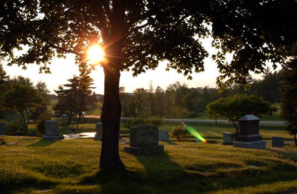 The sun sets on traditional headstones at Mount Hope Cemetery in Bangor in 2006. The cemetery is devoting more and more space to single cremation burial lots, which are only 4 by 4 feet, as well as community manusoleums which house multiple urns.