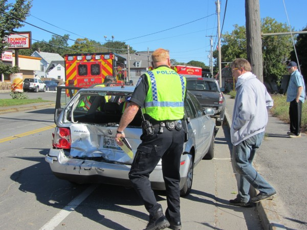 Rockland police Officer Lloyd Daniels examines the damage to one of four vehicles involved in a chain-reaction crash shortly after 10:30 a.m. Thursday on Main Street near the intersection of North Main Street. Two women in separate vehicles were being examined by emergency medical crews, although none of the injuries appeared to be serious. Damage was extensive to two of the vehicles. Traffic continued to be rerouted around the section of Main Street as of 11 a.m.