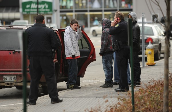 Bangor police remove a handgun from a vehicle after a youth displayed an empty holster and made threats to other youths outside the Penobscot Judicial Center in Bangor in December 2011 after Zachary Carr was sentenced to 35 years in prison in the shooting death of John Bobby Surles.