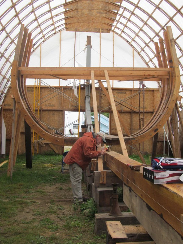 Jay Coffey of Bath makes adjustments to a replica of the 1607 pinnace Virginia on Saturday, September 29, 2012, in Bath. The project is being undertaken by an organization called Maine's First Ship.