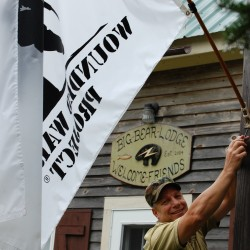 Owner Jim Morse resets the Wounded Warrior Project flag in front of his North Country Adventures camp in the Washington County community of Deblois, Maine.