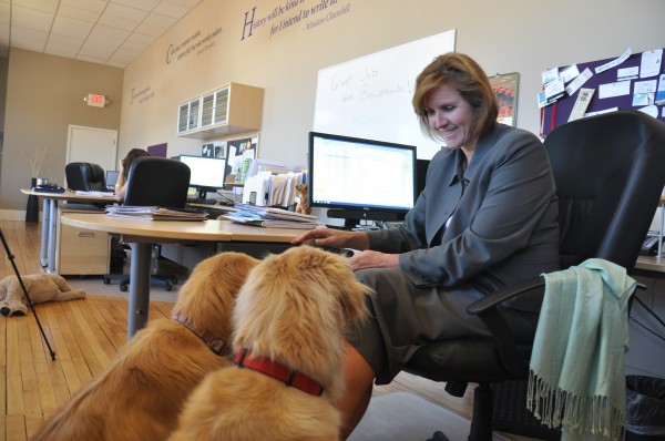 Linda Varrell, president of Broadreach Public Relations in Portland, in the office with her two golden retrievers, Gracie and Zoe.