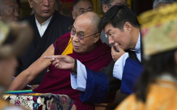 Tibetan spiritual leader the Dalai Lama listens to Lobsang Sangay, the prime minister of the Tibetan government-in-exile, during the Tibetan Democracy Day celebrations at the Tsuglakhang temple in Dharmsala, India, on Sunday, Sept. 2, 2012. On this day in 1960, members of the first Tibetan parliament-in-exile were elected.
