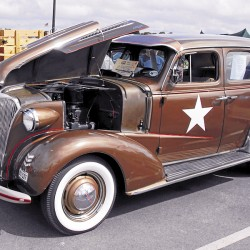 Decked out in an early World War II Army decal scheme, a brown 1937 Chevrolet Master Deluxe Sport Sedan was among the many vehicles displayed at Bangor Waterfront Park during the Sept. 8 Wheels on the Waterfront car show.