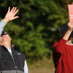 Bangor High School science department head Cary James (left) and earth science and environmental science teacher Ted Taylor look to the sky shortly after their STEM program students launched their weather research balloon from Bangor High School's soccer field area Thursday morning, Sept. 27, 2012.