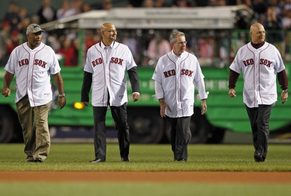 Coaching staff from the Boston Red Sox 2004 World Championship team (from left) DeMarlo Hale, former manager Terry Francona, Dave Wallace and Brad Mills take the field as they are honored before the start of a game between the Boston Red Sox and Tampa Bay Rays at Fenway Park in Boston Sept. 25, 2012. Francona is a candidate for the Cleveland Indians' manager's job.