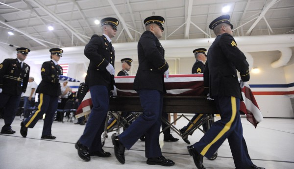 Staff Sgt. Jessica Wing's casket is taken from the Augusta Armory after funeral services Saturday afternoon.