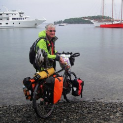 Roger McDougall, 67, of Sydney, Australia, at the end of his trans-American bicycle trek. McDougall began his journey with his back wheel in the Pacific Ocean in Anacortes, Wash. Eighty-five days later, his voyage ended with his front wheel in the Atlantic Ocean in Bar Harbor.