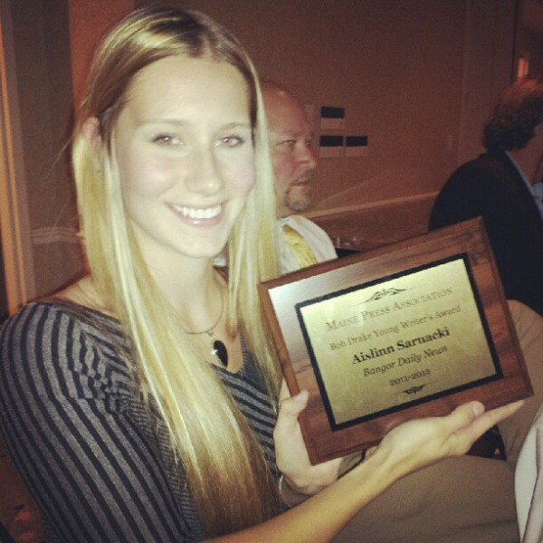 Aislinn Sarnacki being awarded the Maine Press Association Bob Drake Young Writer's Award.