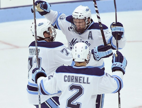 Maine's Spencer Abbott (top) celebrates a goal with Nick Pryor and Mike Cornell during a game last October. Pryor and Cornell are hoping to spark Maine's power play when the Bears host St. Lawrence Friday and Saturday night.