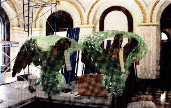 This image, provided by the Portland Police Department Thursday, Oct. 25, 2012, depicts two hand-carved wooden eagle statues as they were recently seen during renovations of the U.S. Custom House on Fore Street. The eagle statues were allegedly stolen from the site over the weekend of Oct. 20.