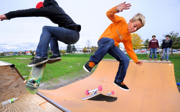 Gage Stuart, 10, of Corinth flips as Chaz Nelson, 20, of Bangor executes a hard flip nose stall while skateboarding at the Bangor Skate Board park Sunday, Oct. 7, 2012. The weather was ideal for such activities over the weekend giving the region a break from the rainy weather that is expected to continue.