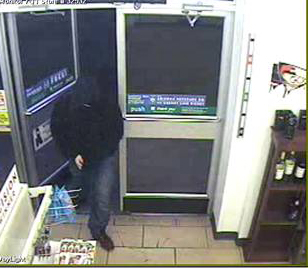 This security camera image, released by the Portland Police Department, depicts a man police say robbed a 7-Eleven convenience store on Washington Avenue on Monday night, Oct. 15, 2012.