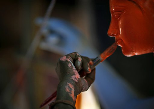 An artist paints idols of Hindu warrior goddess Durga, who destroys demons to prevail over evil, in New Delhi, India on Monday, Oct. 8, 2012. The festival of Durga, who prefers to travel on a lion, will be celebrated from Oct. 20-24, 2012.