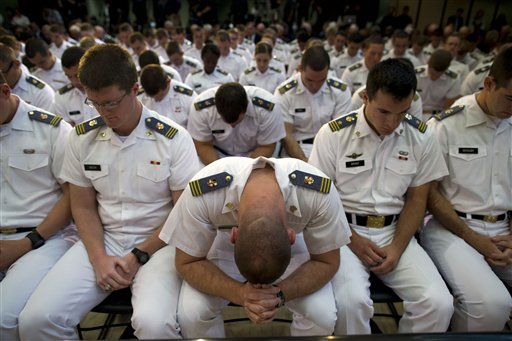 Cadets at Virginia Military Institute pray before a foreign policy speech by Republican presidential candidate, former Massachusetts Gov. Mitt Romney on Monday, Oct. 8, 2012, in Lexington, Va.