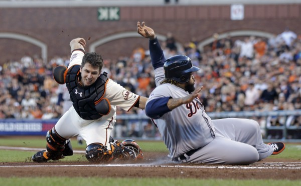Detroit Tigers' Prince Fielder is tagged out at home plate by San Francisco Giants' Buster Posey during the second inning of Game 2 of the World Series Thursday, Oct. 25, 2012, in San Francisco.